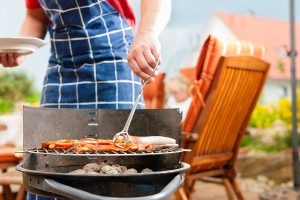 bigstock-Happy-family-having-a-barbecue-21141686