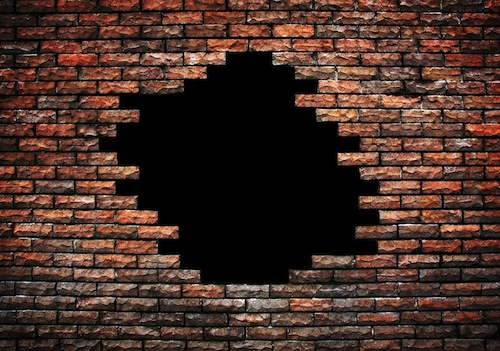 bigstock-large-hole-on-brick-wall-13509374-1